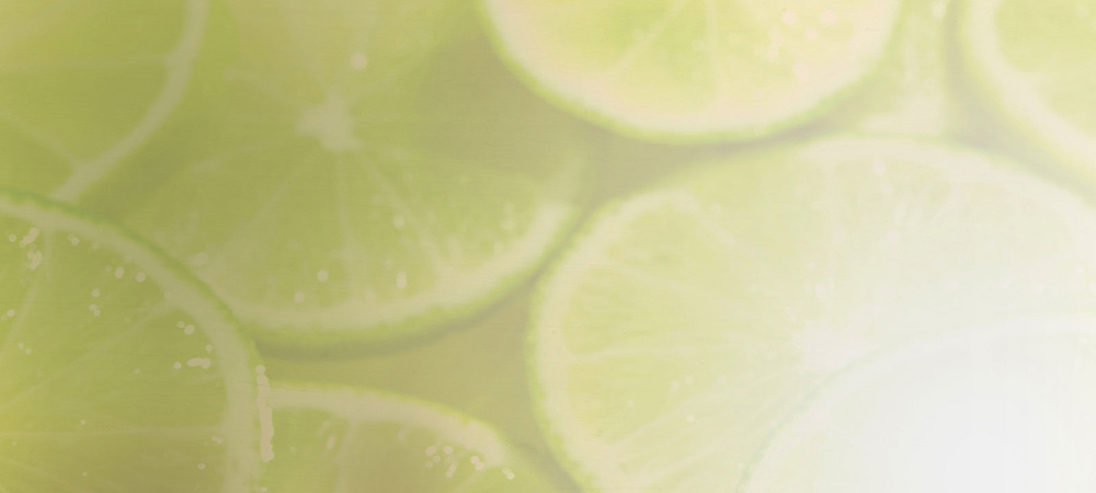 Blurry green-tinted close-up image of slices of lime